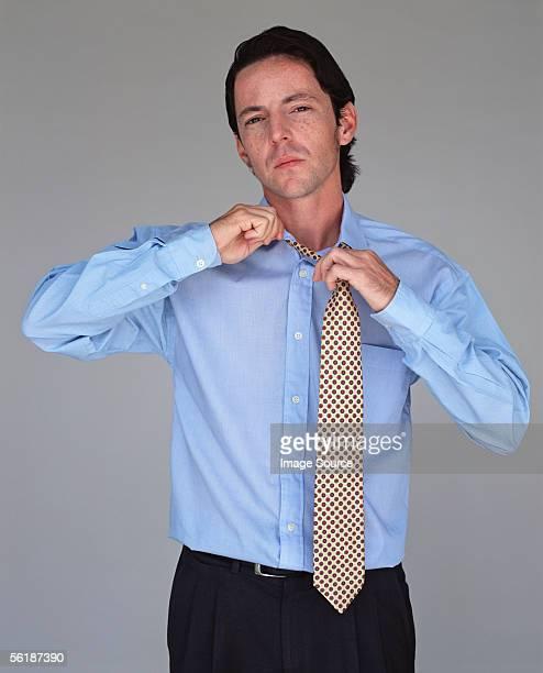 Office worker adjusting his tie