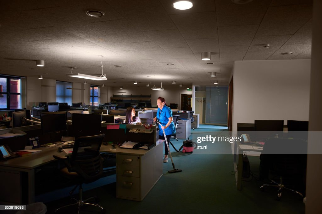 office worker and cleaner chatting : Stock Photo