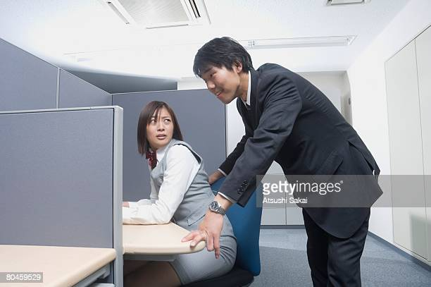 Office worker being harassed by businessman