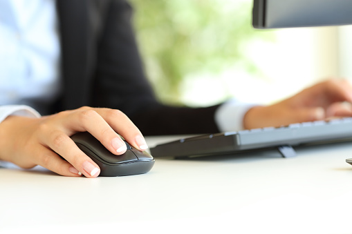 Office worker hand using computer mouse 1133986810