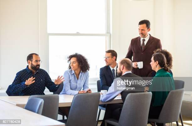 Office Worker Having Idea in Meeting