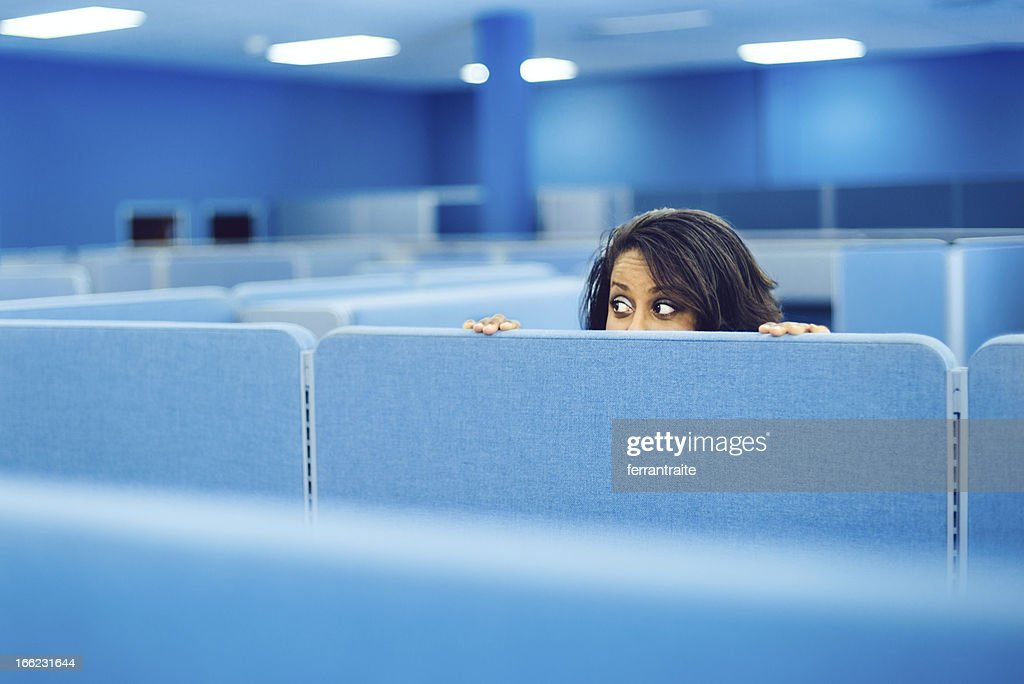 Office Worker Hiding : Stock Photo
