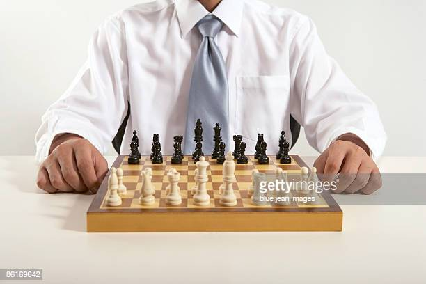 Office worker in front of a chess board
