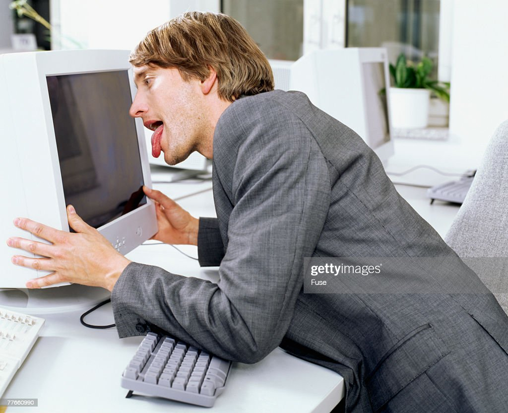 Office Worker Licking Computer Monitor High-Res Stock Photo ...