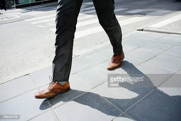 Office worker on sidewalk
