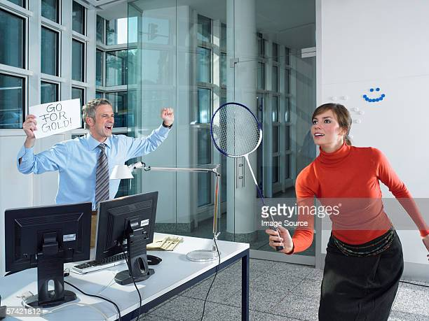 office worker playing badminton - badminton sport stock photos and pictures