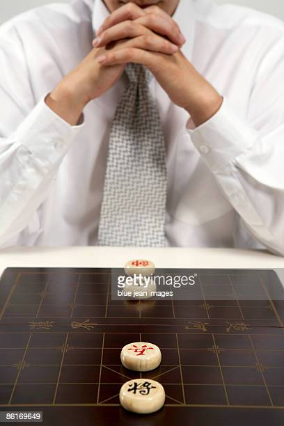 Office worker playing Chinese chess