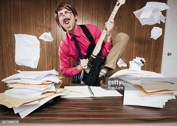Office Worker Playing Electric Guitar