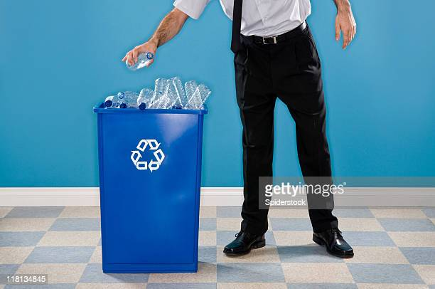 Office Worker Recycling Plastic Bottles.