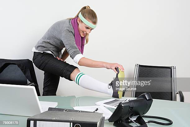 Office worker stretching her leg