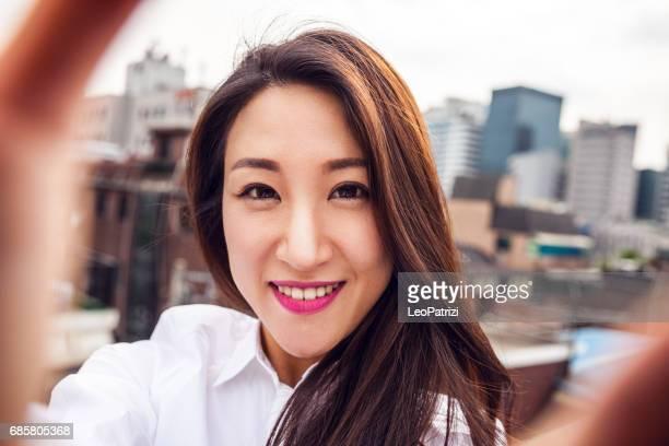 Office worker taking selfie in Seoul downtown