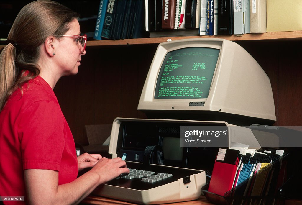 Office Worker Using Computer : Stock Photo