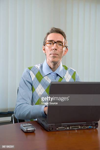 Office worker using laptop computer