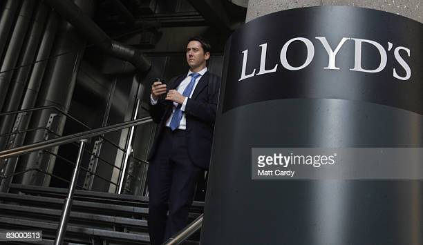 A office worker walks from the Lloyd's Building the home of the insurance institution Lloyd's of London on September 25 2008 in London England Lloyds...