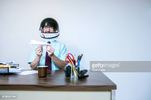 office worker wearing astronaut space helmet - paper airplane stock pictures, royalty-free photos & images