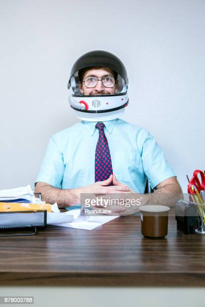 office worker wearing astronaut space helmet - space helmet stock photos and pictures
