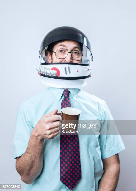 office worker wearing astronaut space helmet - space helmet stock pictures, royalty-free photos & images