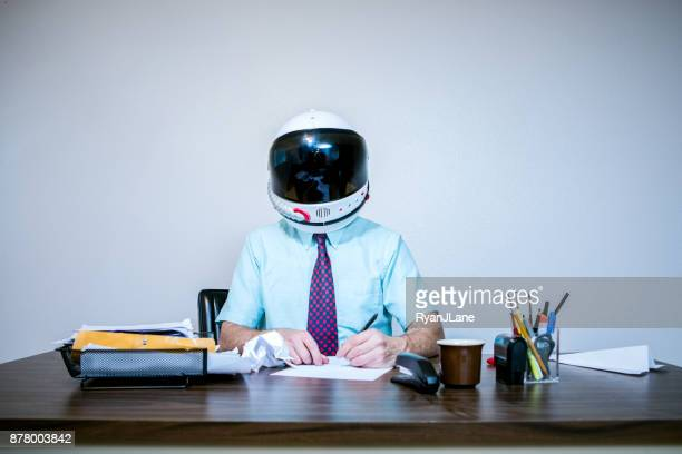 Office Worker Wearing Astronaut Space Helmet