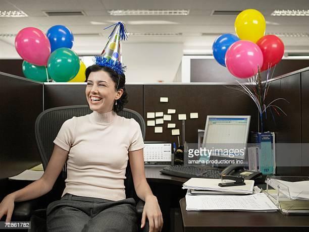 Office worker wearing party hat