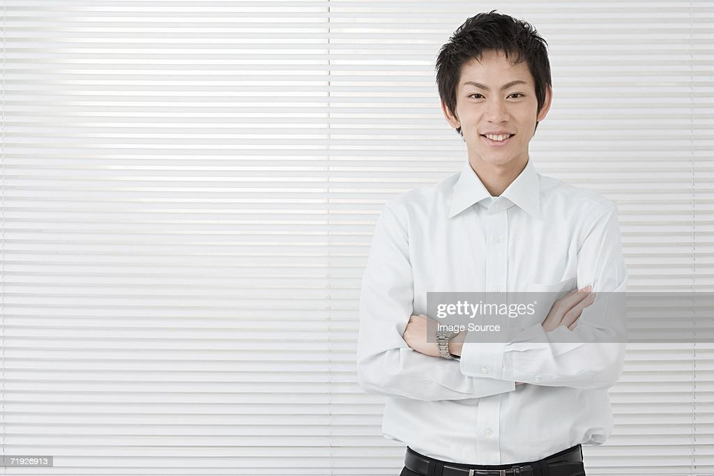 Office worker with arms crossed : Stock Photo