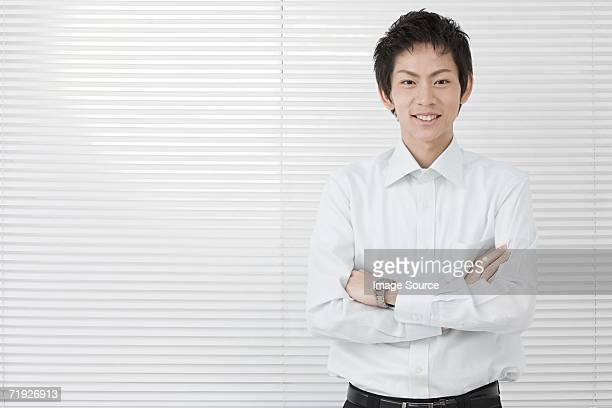 Office worker with arms crossed