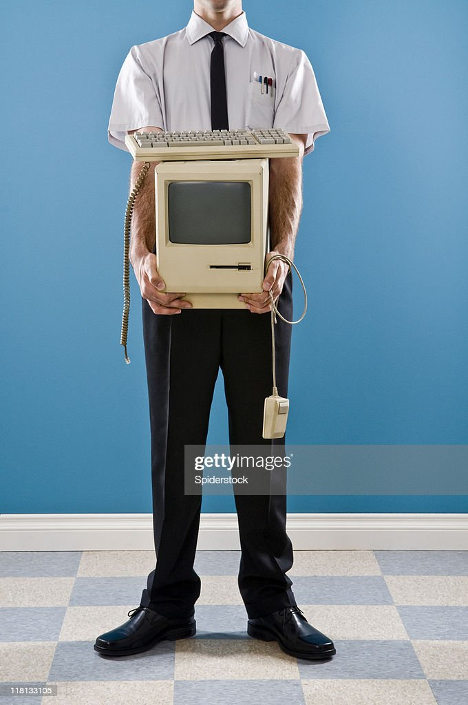 Office Worker With e-Waste : Stock Photo