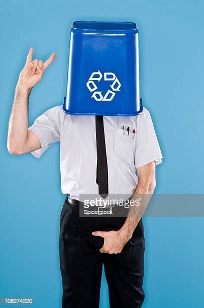 Office Worker With Head Inside Recycling Container