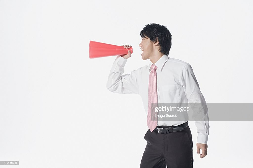 Office worker with megaphone : Stock Photo