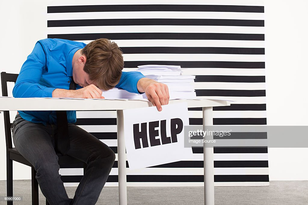 Office worker with sign that says help : Stock Photo