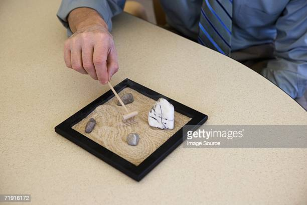 Office worker with zen garden