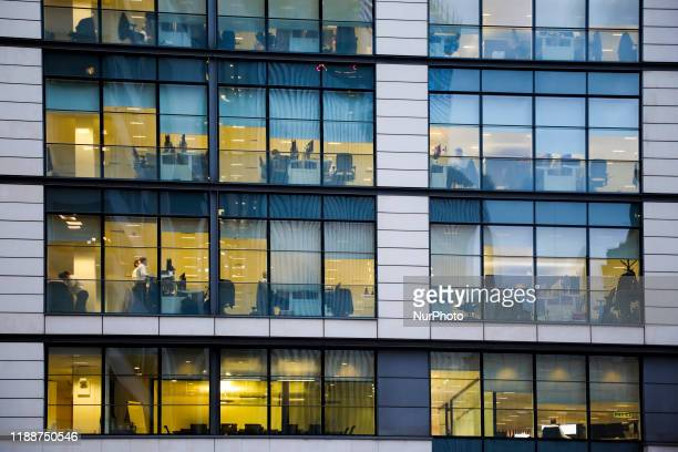 Office workers are seen inside one of the commercial buildings around The City area in London, United Kingdom on 11 December, 2019.
