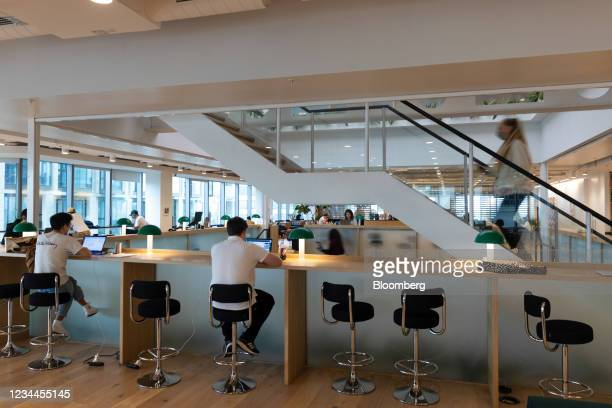 Office workers at bar seats in a WeWork co-working office space in the Waterloo district in London, U.K. On Monday, Aug. 2, 2021. A survey this month...