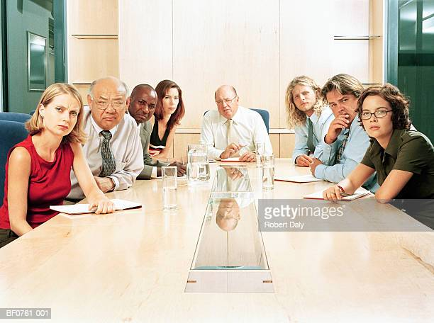 Office workers at boardroom table, portrait