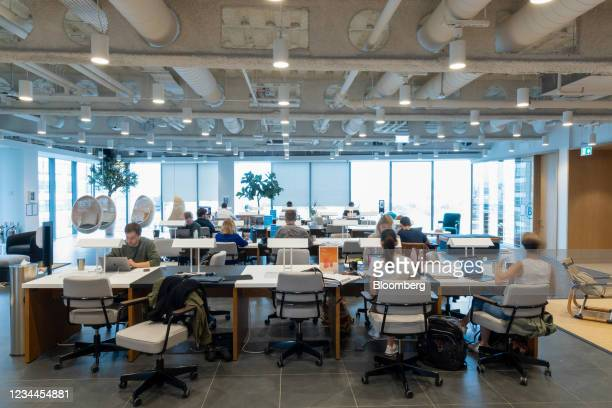 Office workers at desks in a WeWork co-working office space in the Waterloo district in London, U.K. On Monday, Aug. 2, 2021. A survey this month...