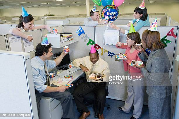 office workers celebrating birthday party, elevated view - work party stock pictures, royalty-free photos & images