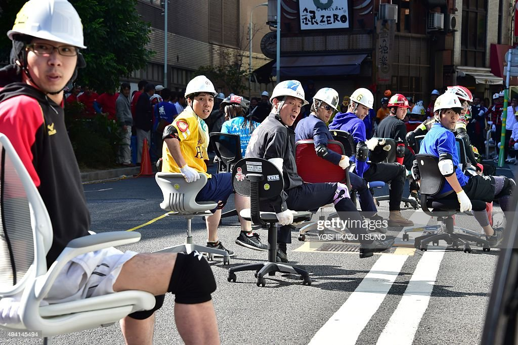 Office workers compete in an office chair race called u0027Isu-one Grand Prix  sc 1 st  Getty Images & Office workers compete in an office chair race called u0027Isu-one ...