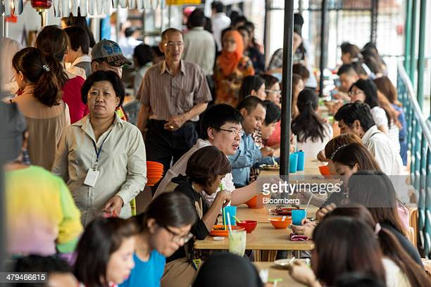 Office workers dine at a food court during lunch hour in Kuala Lumpur, Malaysia, on Tuesday, March 18, 2014. Malaysia, aspiring to become a developed...