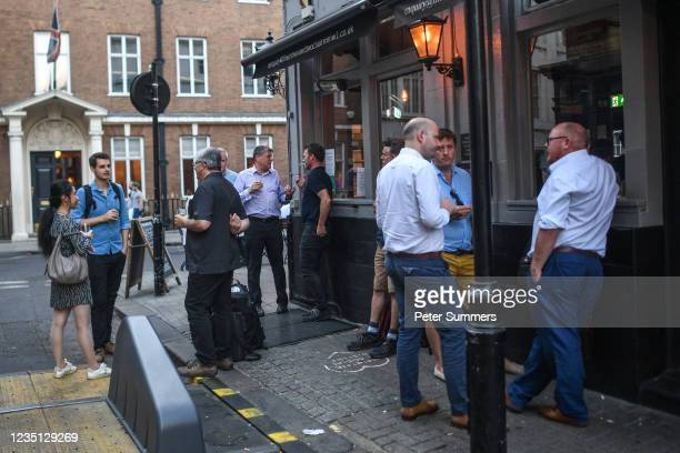 Office workers drink outside a pub on September 8, 2021 in London, England. A recent survey by a recruitment firm showed that 25 per cent of London...