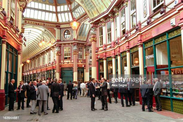 CONTENT] Office workers drinking in the bars of Leadenhall Market in the City of London England UK