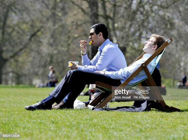 Office workers enjoy the spring weather in Green Park central London