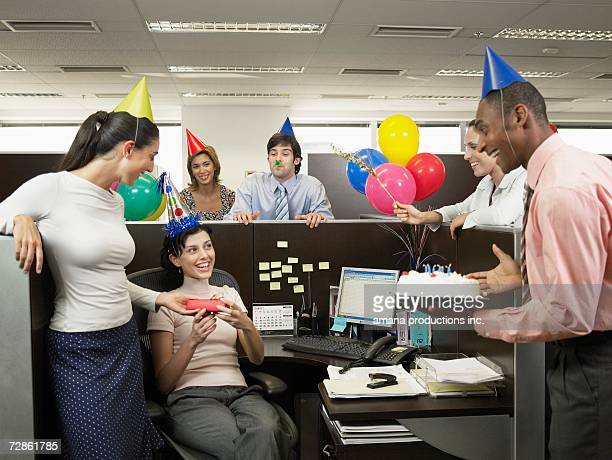 Office workers having birthday party