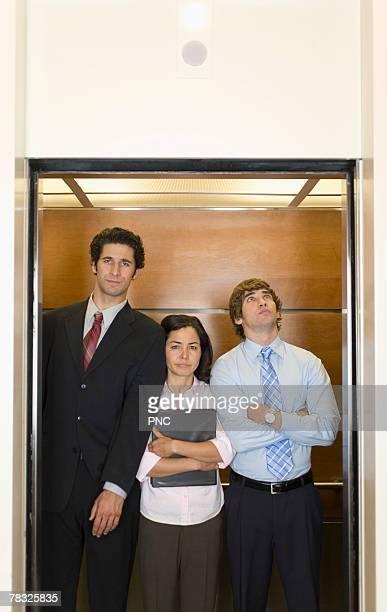 Office workers in elevator