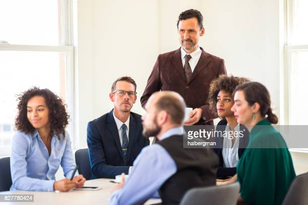 Office Workers in Meeting Looking at Something