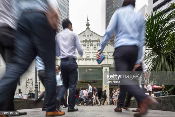 office workers in singapore's financial district. - singapore cbd stock pictures, royalty-free photos & images