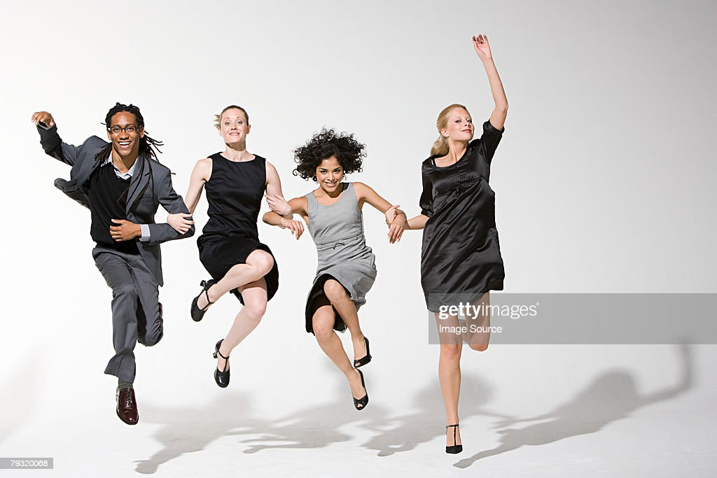 Office workers jumping : Stock Photo