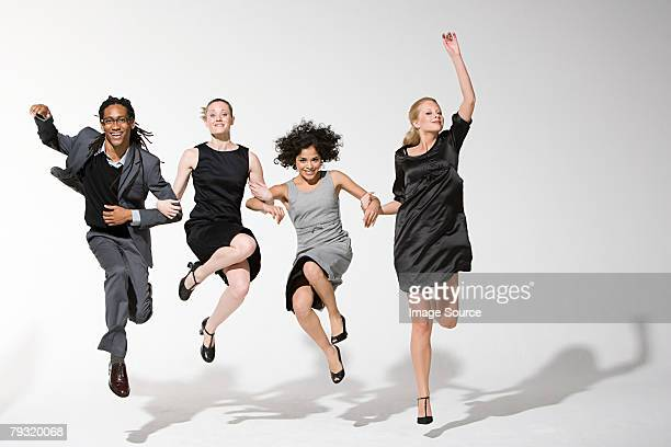 Office workers jumping