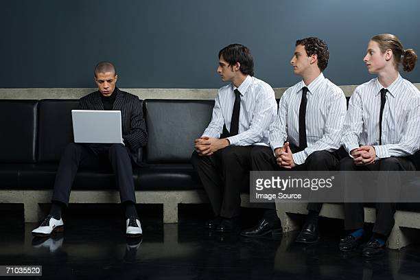 Office workers looking at boss