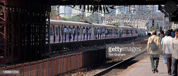 Office workers on crowded commuter train of Western Railway at Mahalaxmi Station on the Mumbai Suburban Railway India