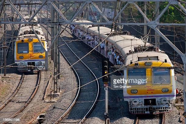 Office workers on crowded commuter train of Western Railway near Mahalaxmi Station on the Mumbai Suburban Railway India