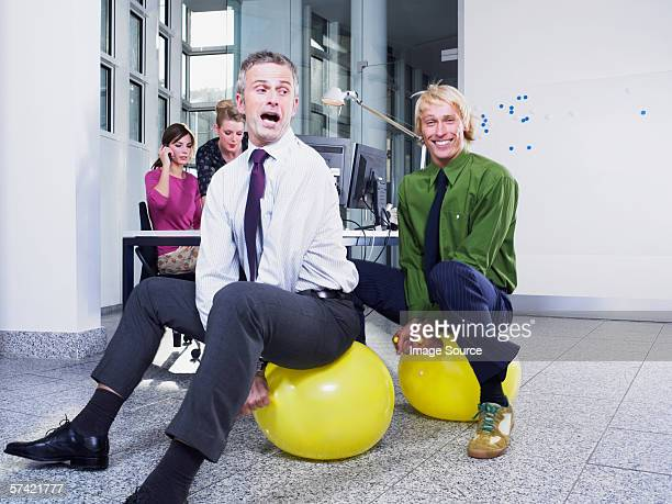 office workers on hoppers - hoppity horse stock photos and pictures